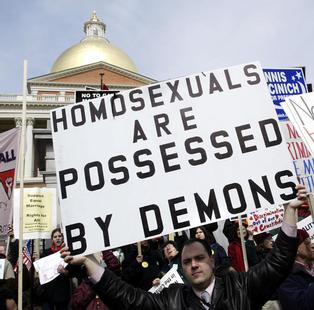 GAY MARRIAGE OPPONENT HOLDS SIGN IN PROTEST OUTSIDE STATEHOUSE